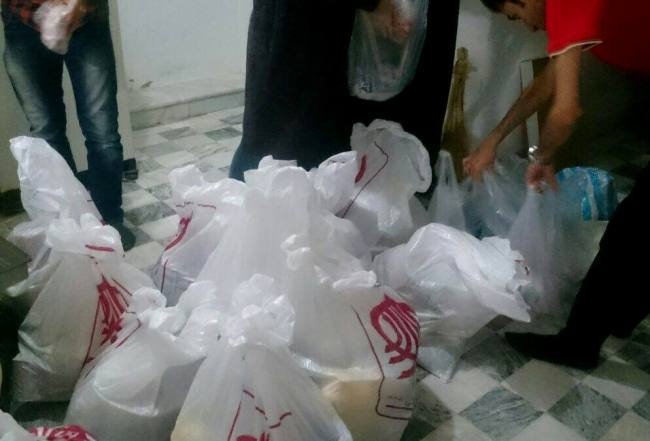 پخش مواد غذایی در محلههای محروم ساری توسط جمعیت امام علی(ع)