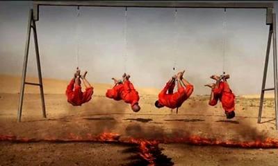 داعش 4 اسیر را اینگونه زنده زنده روی آتش کباب کرد.